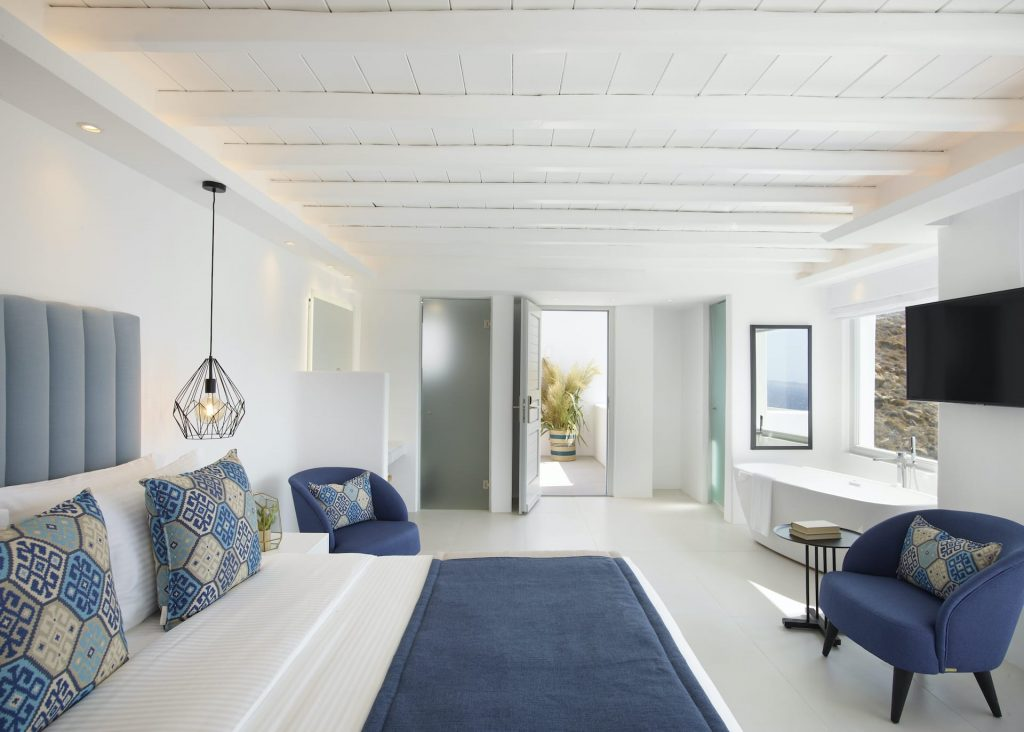 The Epic Blue Executive suite. With Modern Cycladic aesthetic, a double bed, desk, terrace and more.